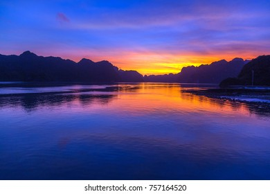 Ha Long bay islands Halong mountains in South China Sea, Sunset over Vietnam. UNESCO World Heritage Site Asia. Indochina Discovery.
