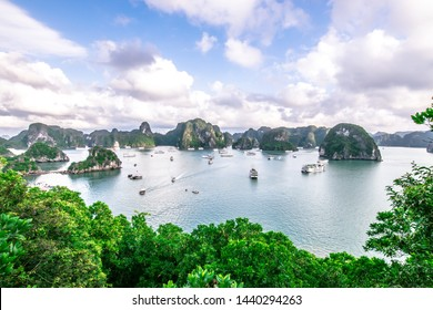 Ha Long Bay, the limestone mountains with blue sky and green trees, is UNESCO World Heritage Site and popular travel destination in Quang Ninh Province, nearby Hanoi,  Vietnam
