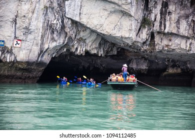 Ha Long Bay, Vietnam - Dec 2017: Enjoying the bamboo boating and kayaking around the Luon cave, Bo Hon island, on one fine day