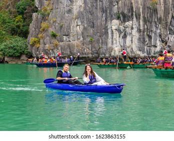 Ha Long Bay, Vietnam - December 17, 2019: Tourists on kayak in Hang Luon Cave.