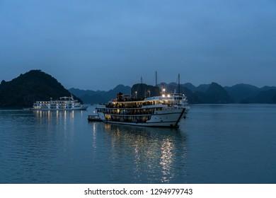 Ha Long bay, Vietnam - January 5, 2019: Alisa Cruise ship in Halong bay at sunset.
