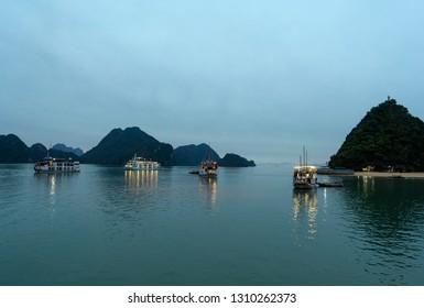 Ha Long bay, Vietnam - January 5, 2019: Cruise ships in Halong bay at sunset.