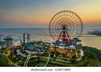 HA LONG, VIETNAM - SEP 28, 2018: Top view aerial photo from flying drone of a Ha Long City with development ferris wheel, aerial cable or telepheric. Near Ha Long bay