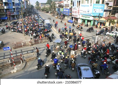 HA NOI, VIET NAM - March 27, 2014: Traffic in Hanoi, Vietnam - Dense, crowed scene of city traffic in rush hour, crowd of people wear helmet, transport by motorcycle in stress situation in morning.