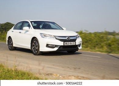 Ha Noi, Viet Nam - Sep 27, 2016: Honda Accord all new 2016 car is running on the test roat in test drive, Vietnam. (Image may contain noise,soft and blurry effect due to long exposure).
