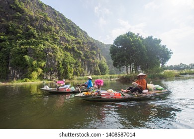 Ha Noi, Vietnam - 5 December, 2018 : vendor on boat travel around Tam Coc beatiful nature river and mountain, Tam Coc Ninh Binh, Vietnam. subject is blurred.