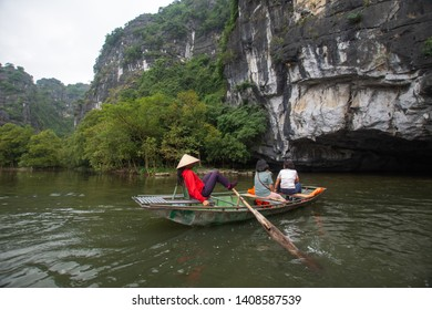 Ha Noi, Vietnam - 5 December, 2018 : tourist sitting on boat for travel around Tam Coc beatiful nature river and mountain, Tam Coc Ninh Binh, Vietnam. subject is blurred.