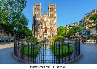 """HA NOI, VIETNAM - AUG 08, 2018: St. Joseph's Cathedral (simply called """"Big Church"""" in Vietnamese), Nha Chung Street near the Hoan Kiem Lake."""