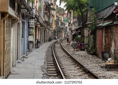 Ha Noi,Vietnam-April 18,2018: Railway passing on the residential street in Hanoi, the train passes straight through this narrow street twice a day.
