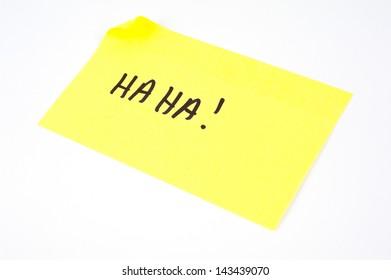 'Ha Ha!' written on a yellow sticky note