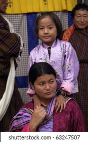 HAA, BHUTAN - SEPTEMBER 21: unknown spectators at the religous festival named Tshechu in the White Temple (Karpho Lhakhang) on September 21, 2007 in Haa, Bhutan