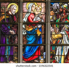 Haacht, Belgium - May 30, 2015: Stained Glass depicting the Three Kings visiting the infant Jesus in the Church of Haacht, Belgium.
