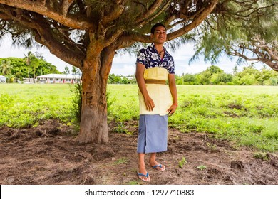 Haapai, Tonga - 5 Jan 2014: Smart well dressed Polynesian teenager boy in traditional Tongan dress just out of church as Catholic Mass ends, Pangai village, Ha'apai Group in Tonga, Polynesia, Oceania.