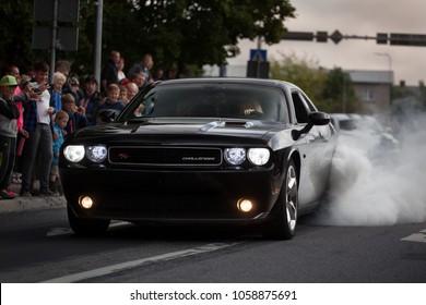 Haapsala, EE - JUN 18, 2016: Dodge Challenger RT HEMI V8 make tire smoke and burn out during American car show