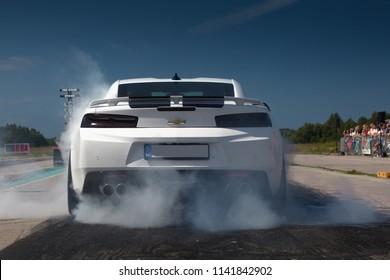 Haapsalu, Estonia - JUL 15, 2018: American Car Beauty Show Chevrolet Camaro SS 2018 make burnout warm up on drag strip