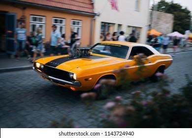 Haapsalu, Estonia - JUL 15, 2018: American Car Beauty Show 1970 Dodge Challenger RT at the small old street