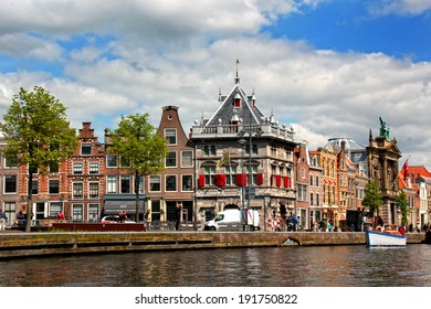 HAARLEM - MAY 3: Historical houses along a canal in old Haarlem on May 3, 2014, Haarlem, The Netherlands.