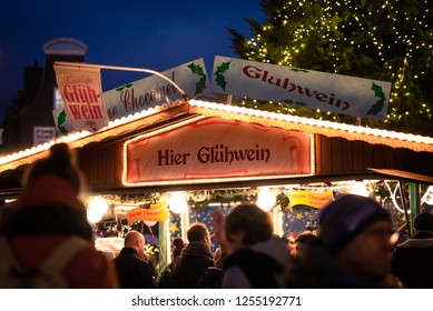 Haarlem, Netherlands - 12.9.2018: A vendor stand at a Christmas market selling mulled wine (gluhwein) and hot chocolate (warme chocomel) during the holiday season. Happy crowd and traditional drinks.