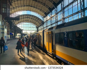 Haarlem, Netherlands, 18-04-2019: A dutch train just arrived at the platform of Haarlem station on a bright sunny day in Haarlem, Netherlands