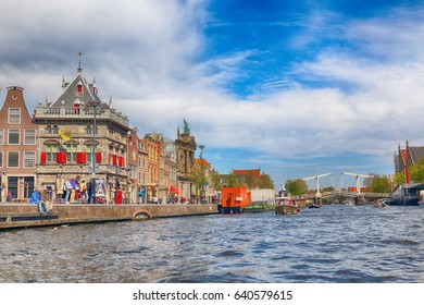 HAARLEM, NETHERLANDS - APR 30, 2017 : Canal with historical houses in old Haarlem. Typical Dutch architecture. View from the boat level.