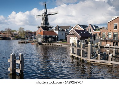 HAARLEM, NETHERLANDS - APRIL 13, 2019: Old windmill in the city center of Haarlem on April 13, 2019 in the Netherlands