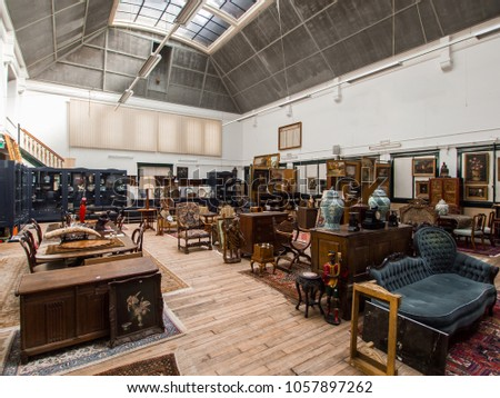 Large Hall Of An Auction House Full Of Antique