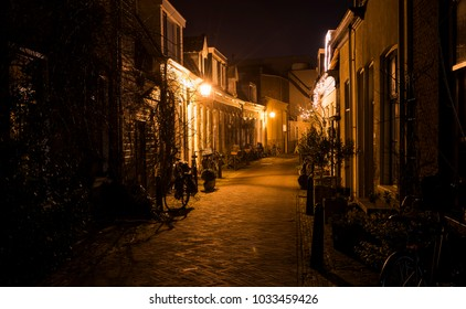 Haarlem, The Netherlands - February 20, 2018: Bloemerstraat at night with monumental houses and bikes in Haarlem.
