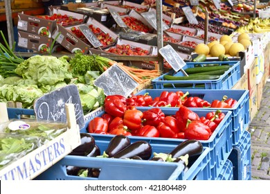 Haarlem, Netherlands - June 13, 2015: Fruit market with various fruits and vegetables in a row. Fresh vegetables and fruits at a market stall.