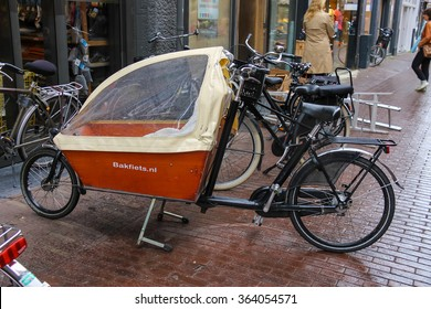 Haarlem, the Netherlands - June 20, 2015: Cargo bike with protect tent parking on the street. Haarlem is the popular holland tourist centre