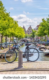 Haarlem, The Netherlands - May 31, 2019: Scenic view with a classic Dutch bike parked at the famous Begijne bridge in Haarlem in the Netherlands