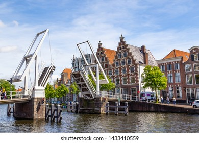 Haarlem, The Netherlands - May 31, 2019: Cityscape Haarlem with gable hosues, bridge, canal and canala cruise boat in the Netherlands