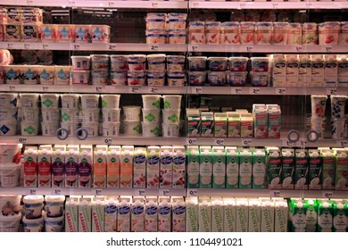 Haarlem, the Netherlands - may 8th 2016: Dairy products, yogurt and quark in a supermarket fridge.  Text on labels: product descriptions in Dutch, prices in Euro