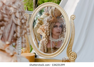 HAARZUILENS,THE NETHERLANDS - APRIL 17: Unidentified woman in classical costume at the yearly Fantasy Fair event on April 17,2011 in Haarzuilens,Utrecht The Netherlands.