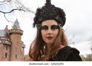 HAARZUILENS,THE NETHERLANDS - APRIL 21: Woman dressed in black posing at the yearly Fantasy Fair event on April 21,2012 in Haarzuilens,Utrecht The Netherlands.