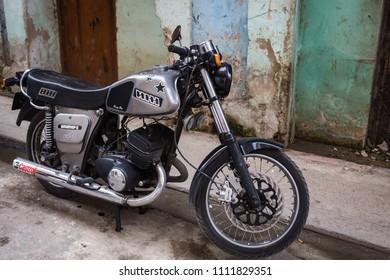 HABANA, CUBA-JANUARY 13: Motobike on January 13, 2018 in Habana, Cuba. Motobike on a street of Habana
