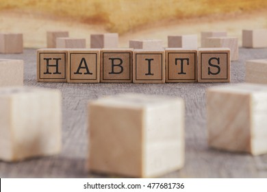 HABITS word written on building blocks concept