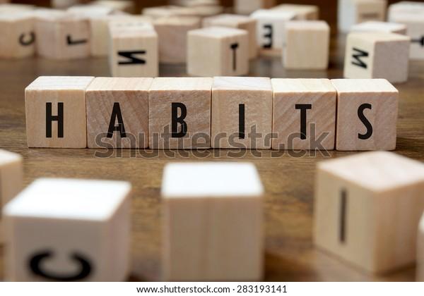 habits word written on wood block
