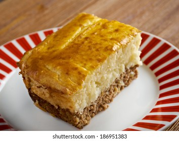 Hachis Parmentier - dish made with mashed, baked potato, combined with diced meat.s named after Antoine-Augustin Parmentier, a French pharmacist