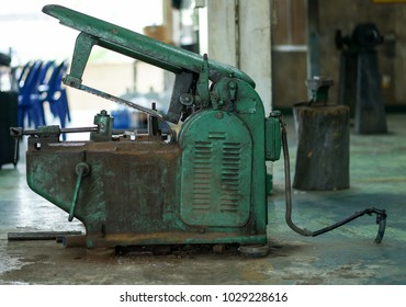 Hack sawing machine working to cutting a metal.The image contain soft focus, noise and grain.