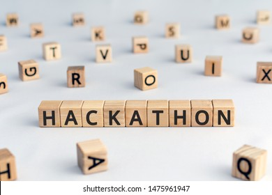 Hackathon - word from wooden blocks with letters, hackathon  hack day, hackfest or codefest event concept, random letters around, white  background