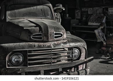 Hackberry, Arizona, USA, April 5, 2019, General Store and Route 66 museum, vintage garage scene with an old Ford pickup truck and male and female mannquins repairing an engine