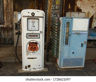 Hackberry, Arizona, USA - February 17, 2020: Vintage Phillips 66 gas pump and antique RC Cola vending machine at a remote gas station on Route 66.