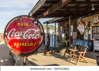 Hackberry, Arizona, USA - February 17, 2020: Vintage drink Coca Cola sign at a historic Route 66 general store on a remote Arizona highway.
