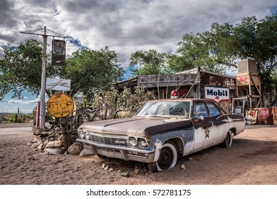HACKBERRY, ARIZONA, USA - MAY 19, 2016 : Old sheriff's car wreck with a siren left abandoned near the Hackberry General Store. Hackberry General Store is a famous stop on the historic Route 66.