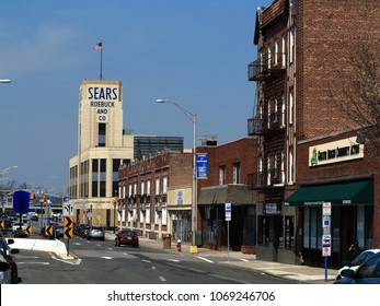 HACKENSACK, NEW JERSEY - APRIL 14: Vintage Sears Roebuck department store in a small town setting on April 14, 2018 in Hackensack, NJ. Sears was founded in 1982 as a mail order catalog company.