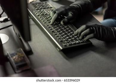 Hacker arms typing on keyboard