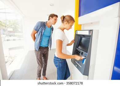 hacker in atm trying to steal pin code of woman's credit card