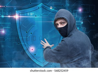 hacker breaking cyber security protection