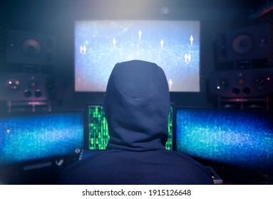 Hacker coding virus ransomware using laptops and computers. Cyber attack, system breaking and malware concept.