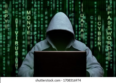 Hacker at the computer. Cyber espionage and digital security